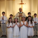 2018 FIRST COMMUNION CLASS Front Row- Isabella Lockard, Lillian Larsen, Natalee Langston, and Aiden Marshall Back Row L-R Dylan Hollis, Brody Binion, Fr. Tony Arguelles, Trayson Crabtree, and James Shadrick